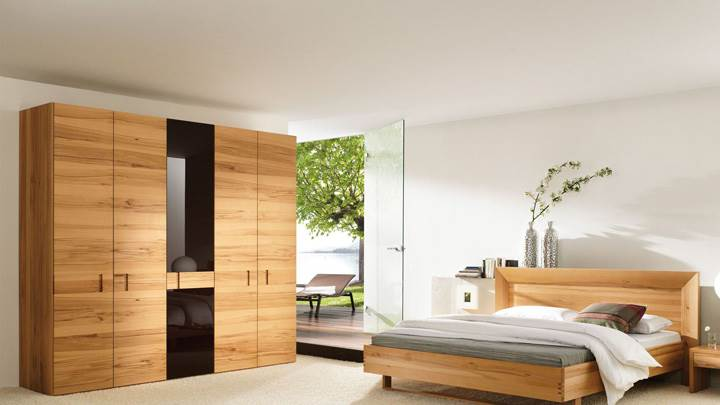 Wooden Furniture And Bed In Bedroom