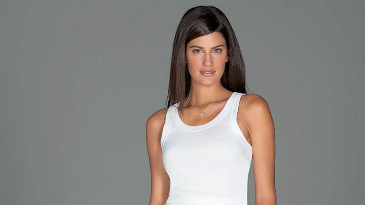 Yamila Diaz Smiling In White Top Modeling Pose