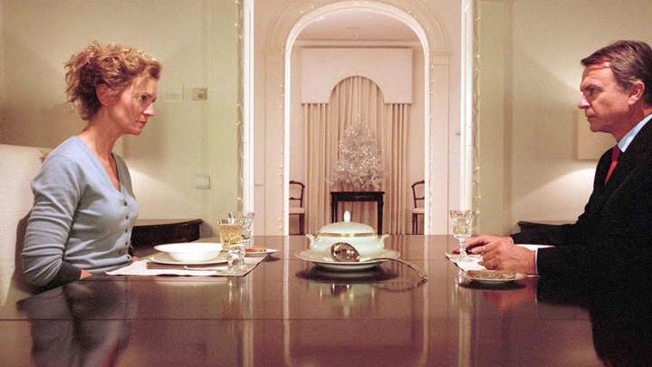 Yes – Joan Allen And Sam Neill Sitting On Dining Table