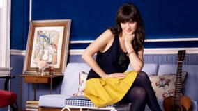 Zooey Deschanel In Black Top Cute Sitting Pose Photoshoot