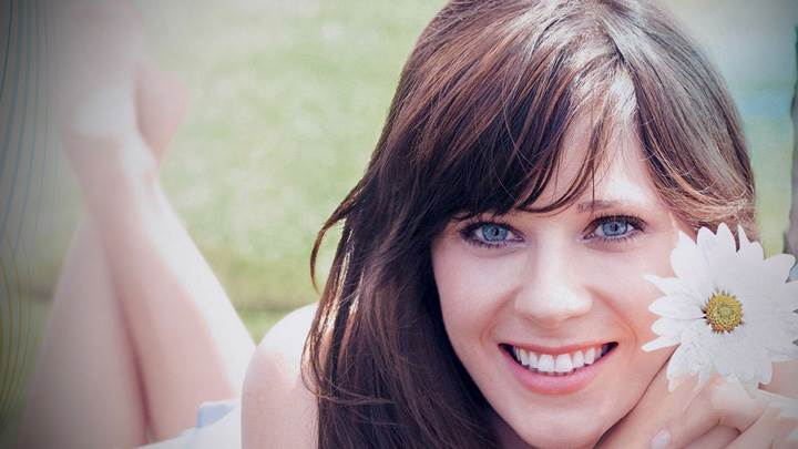 Zooey Deschanel Smiling Cute Looking Laying Pose