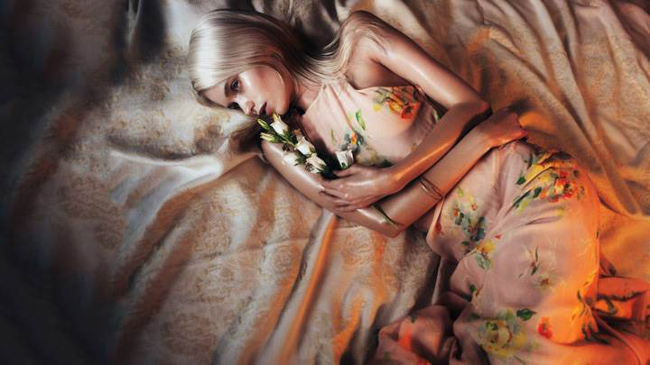 Abbey Lee Kershaw – Laying On Bed In Colorful Dress