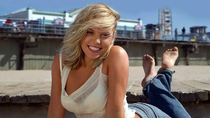Agnes Bruckner Laying In White Top And Blue Dress