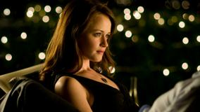 Alexis Bledel Side Sitting Pose In Black Dress