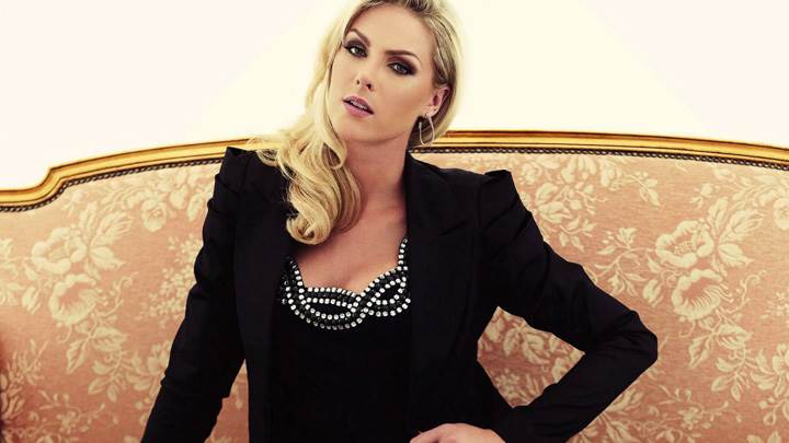 Ana Hickmann In Black Dress Sitting Front Pose