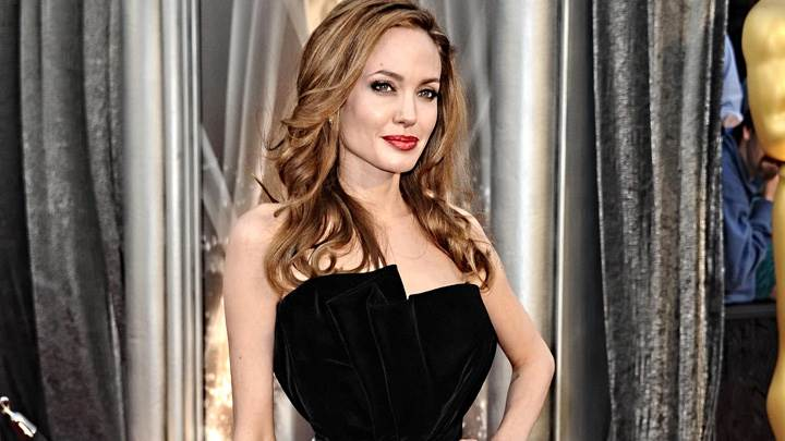 Angelina Jolie In Black Dress Modeling Pose Photoshoot