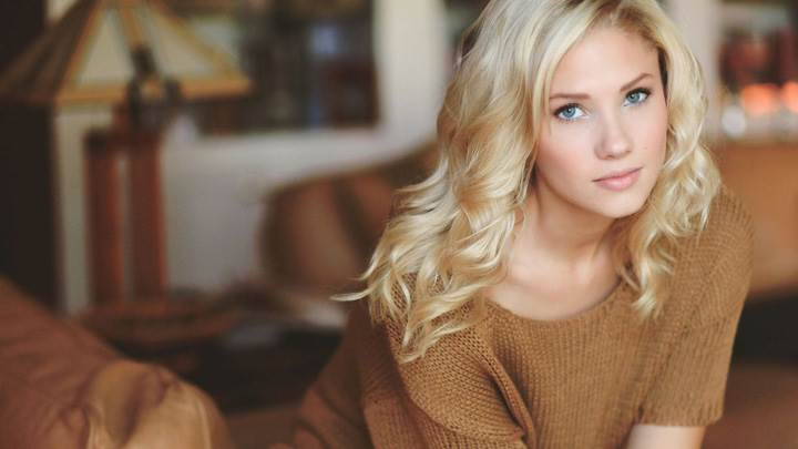 Berit Birkeland Sitting Pose In Brown Woolen Dress