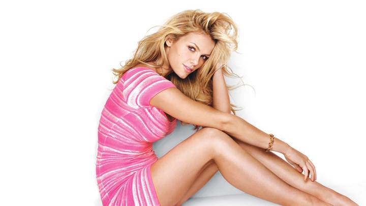 Brooklyn Decker Sitting In Pink Dress Side Pose