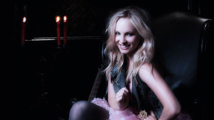 Candice Accola Smiling Sitting Pose