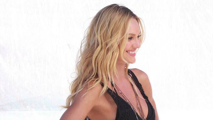 Candice Swanepoel Smiling In Black Dress Side Pose
