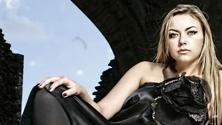 Charlotte Church Sitting In Black Dress Looking At Camera