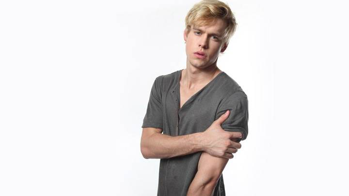 Chord Overstreet In Grey T-Shirt And White Background