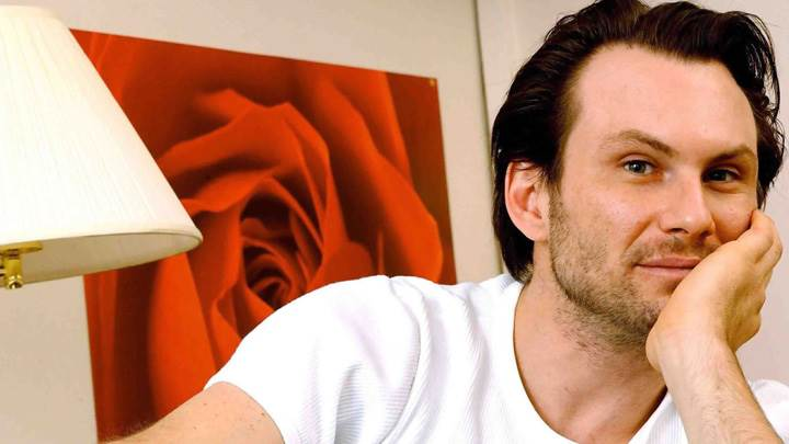 Christian Slater Looking At Camera In White T-Shirt