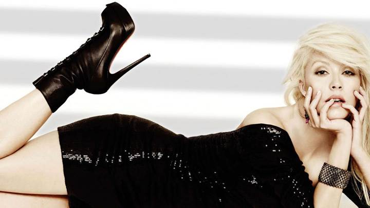 Christina Aguilera Laying Pose In Black Dress