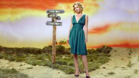 Christina Applegate Standing In Green Dress Near Sign Board