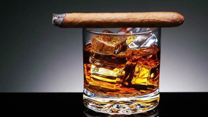 Cigar And Ice Cubes In Whisky