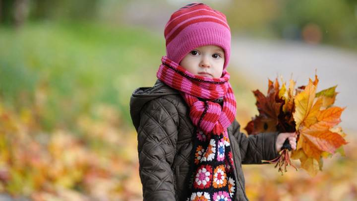 Cute Baby Looking Front In Autumn