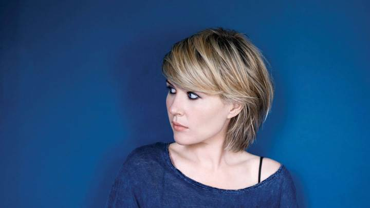 Dido Looking Side In Blue Top N Blue Background