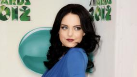 Elizabeth Gillies Smiling Side Pose