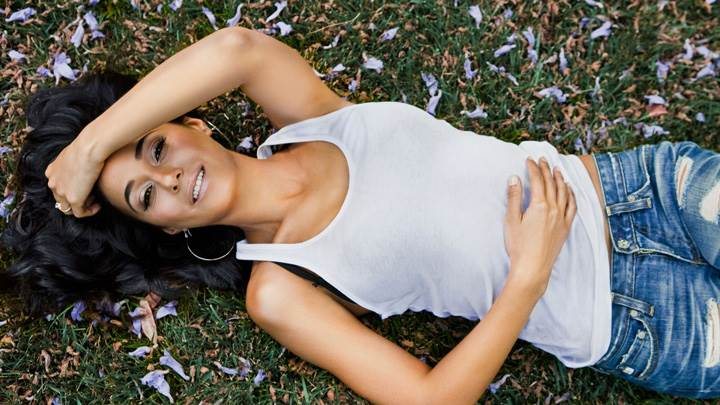 Emmanuelle Chriqui Smiling Laying Pose In White Top