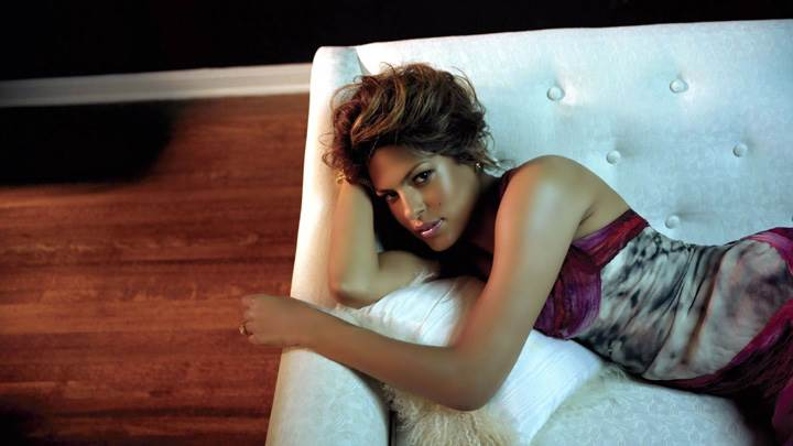 Eva Mendes Laying Pose On White Sofa