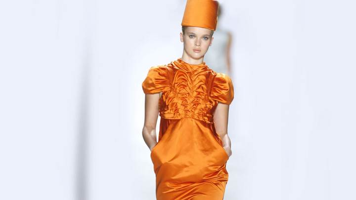 Eva Padberg In Orange Dress Modeling Pose