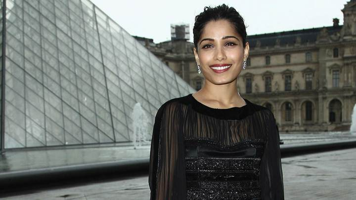 Freida Pinto In Black Dress At Salvatore Ferragamo Cruise Collection 2013 Show