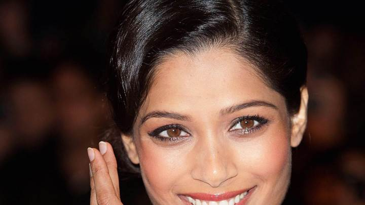 Freida Pinto Glossy Pink Lips Near Sea Side At Desert Dancer Photocall