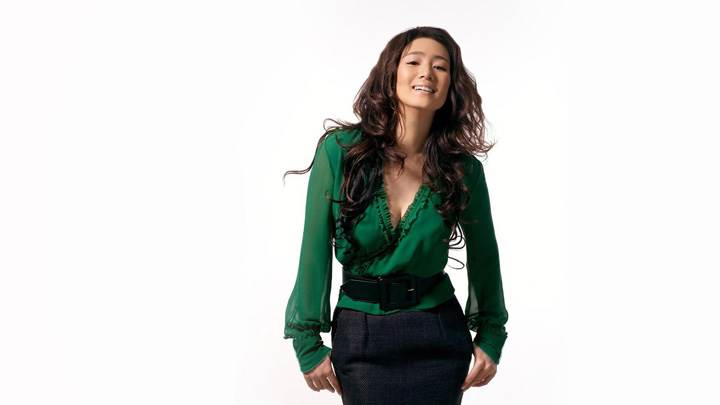 Gong Li Laughing Face In Green Dress N White Background