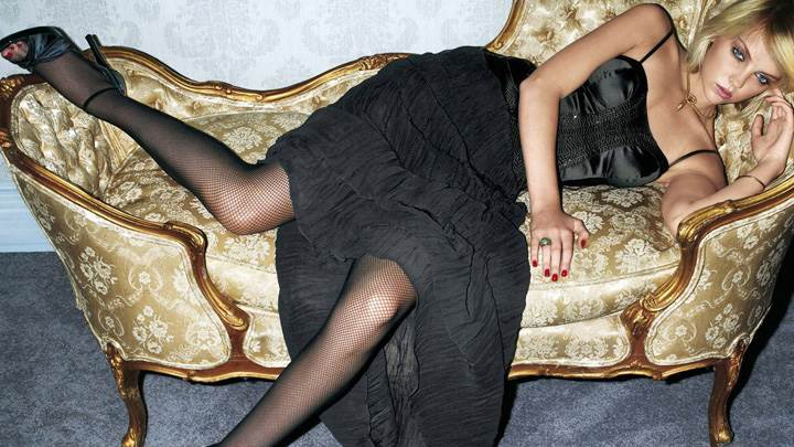 Heather Marks Laying On Sofa In Black Dress