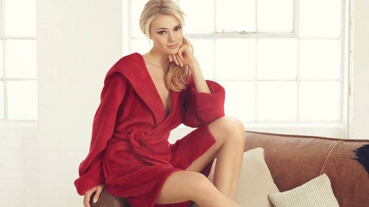 Jacqui Ainsley Sitting Pose On Sofa In Red Coat