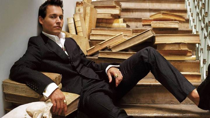 Johnny Depp Sitting In Stairs in Black Coat