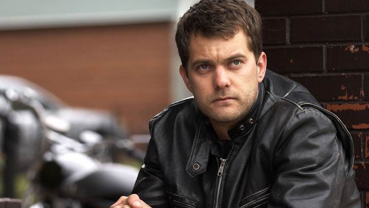 Joshua Jackson Sitting In Black Jacket