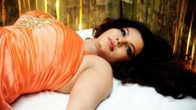 Rakhi Sawant Sexy Laying Pose In Orange Dress