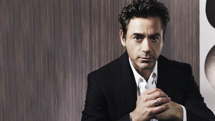 Robert Downey, Jr Sitting Pose In Black Coat