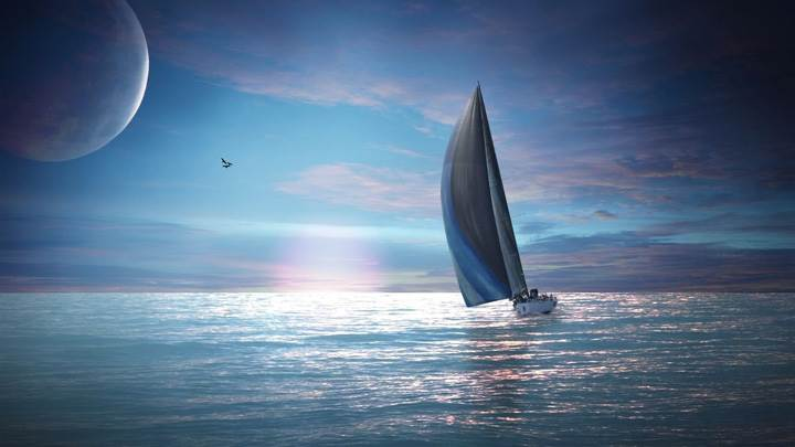Sailing Boat In Sea At Sunset
