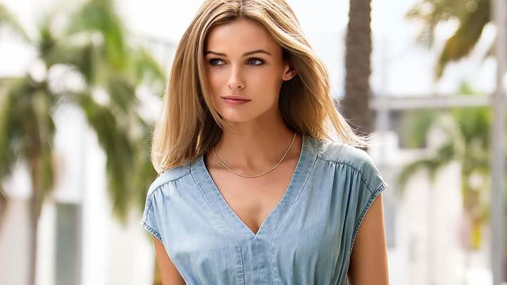 Smiling Face Of Edita Vilkeviciute In Blue Dress