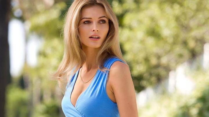 Side Pose Of Edita Vilkeviciute In Blue Dress