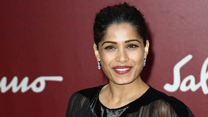 Smiling Freida Pinto At Salvatore Ferragamo Show
