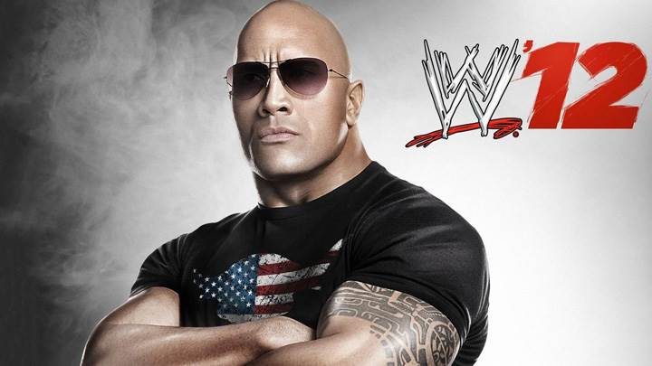 WWE 12 The Rock – In Black T-Shirt And Goggles