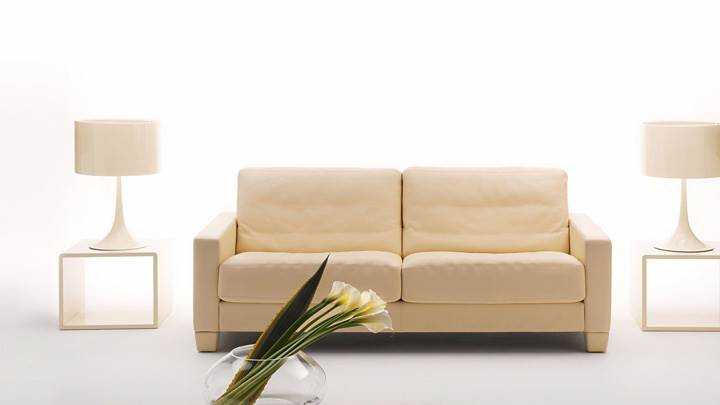 White Background And Lamps Side Of Sofa Set