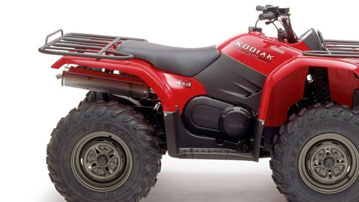 Yamaha Kodiak 450 In Red Side Pose And White Background