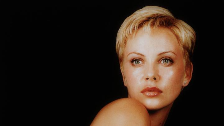 Charlize Theron Looking At Camera At Christopher Kolk Photoshoot And Black Background