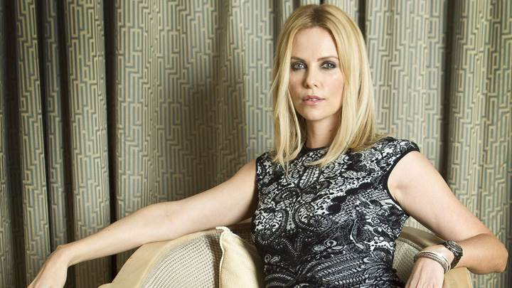Charlize Theron Sitting Pose At Joel Ryan Portraits London