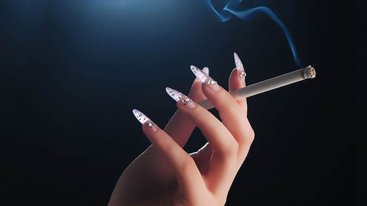 Cigarette In Girls Hand Closeup