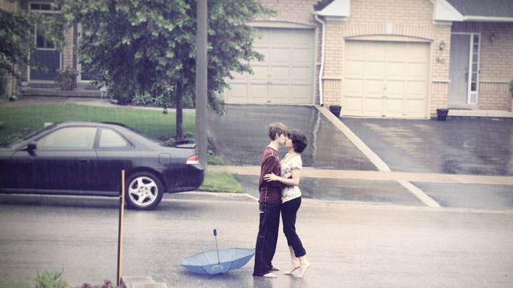 Couple Kissing on Road In Rain