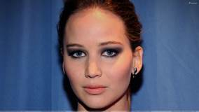 Jennifer Lawrence Looking At Camera Front Face Closeup N Blue Background
