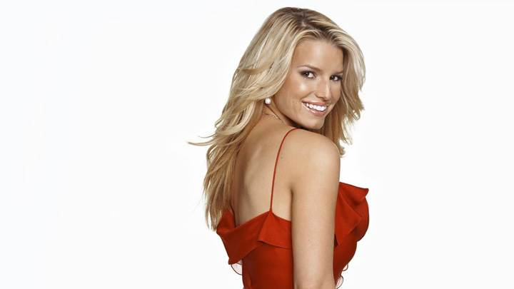 Jessica Simpson Smiling Side Pose In Red Dress