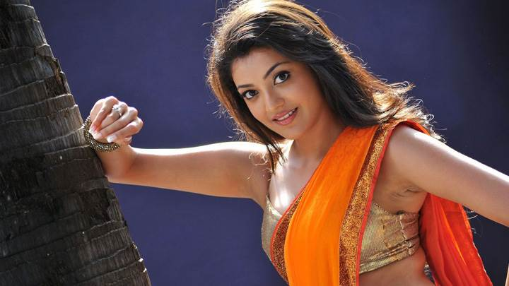 Kajal Aggarwal In Orange Saree In Business Man