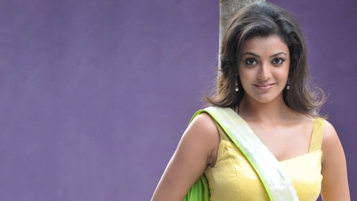Kajal Aggarwal Looking At Camera In Yellow Dress